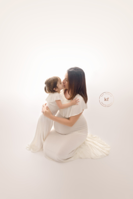 backlit_maternity_photo_north_branch_michigan_newborn_photography_mother_daughter