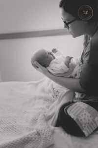 new mom holding newborn son at lapeer mclaren hospital fresh 48 photo by kat fantin photography